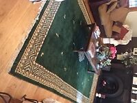 LARGE LUXURY WOLLEN RUG. EXCELLENT CONDITION- LIKE NEW. 7 FOOT BY 12 FOOT