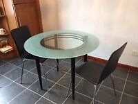 Glass dining table and 2 chairs- great for small space