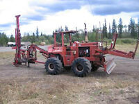 Ditch Witch R100 with King Hitter post pounder driver