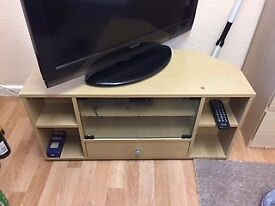 Small wooded TV stand with glass doors