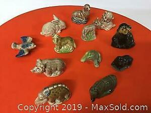 Lot of 12 Wade tea figurines, including rares