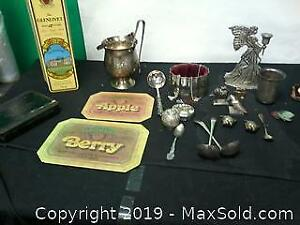 Variety of items, old tin cans, candle holder...
