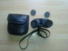 Binoculars Sunagor 8-24x25 pocket mini zoom with case, lens and neck strap, field 2.3 at 24 power.