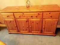 Pine dining room furniture. Round extending table, four chairs, large 4 door sideboard, TV unit.