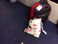 White pink and purple ski boots