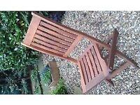 4 wooden garden chairs.