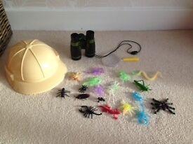 Bugs, binoculars and explorer hat