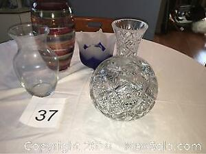Crystal vase with small chip, One Glass, and blue Vase.