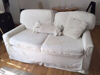Comfortable cream two-seater sofa bed - hardly used sofa