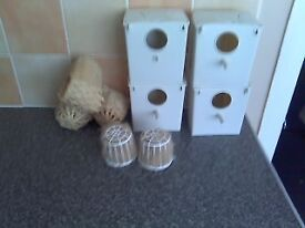 4 plastic finch boxes and 3 baskets
