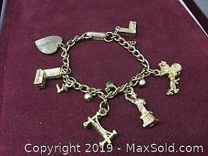 Lot Of 6 Gold Tone Charms On Bracelet