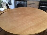 Lovely round kitchen table and four chairs which slide under table when not in use