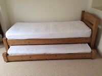 Taurus 'Adelaide' solid pine small single bed with accompanying trundle bed and mattresses.