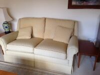 Two 2-seater Delcor sofas in gold/yellow fabric in good condition. Armchair but needs cleaning