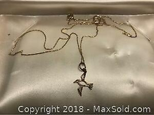 Gold Necklace With Bird Pendant