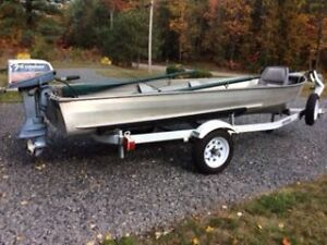 14 ft fishing boat with 7.5 hp Evinrude motor and Trailer