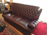 Oxblood leather 'chesterfield' style 3 seater sofa 2 armchairs and foot stool good condition