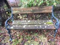 Vintage Wooden Garden Bench with Ornate Green Cast Iron Frame