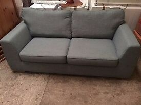Large green sofa at Cambridge Re-Use (reuse)