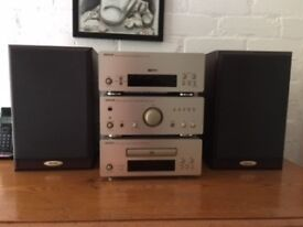 Denon 3 tier Stereo (CD player, Amplifier and AM-FM Tuner) with 2 bookshelf speakers.