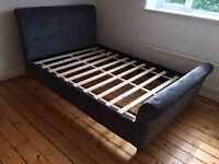 BUTTONED UPHOLSTERED DOUBLE SLEIGH BED