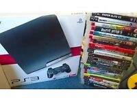 PS3 Console with 2 controllers, singstar microphones and 24 games