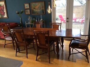Walnut Dining Table and 6 grange chairs with cane backs