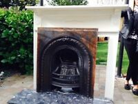 Cast iron fire place with hearth and surround
