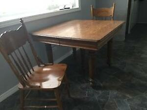 Antuique table and 4 press back chairs and 3 leafs
