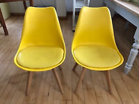 Two yellow dining chairs