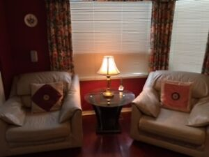 GREAT DEAL!! 2 LEATHER SINGLE SEATER SOFAS - $60 ONLY