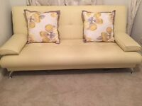 Sofa bed and cushions for sale- only a year old in very good condition.