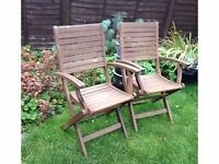 Two folding garden armchairs