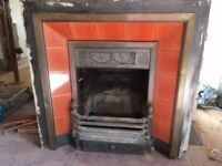 Tiled metal fire back panel and grate.