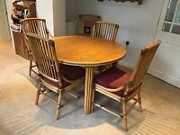 British made Angrave extendable table and four chairs.