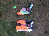 2 Nerf blasters which take plastic disc ammunition.