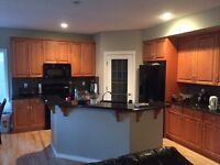 large executive house has bottom floor for rent. share L kitchen