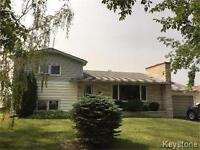 Immaculate 4 level split home on spacious lot in Rossburn!