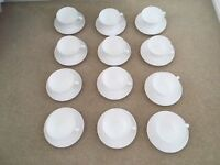 12 white bone china cups and saucers