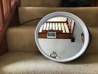 circular mirror recessed in white frame 1960s?
