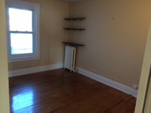 One (1) bright bedroom on 2nd floor of house - Close to Queen's