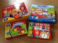 4 orchard toy games. Greedy gorillas, bus stop tell the time and ladybirds