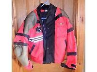 Mens Red Motor Bike Jacket & trousers Motrax size large Trousers Bufallo size medium.