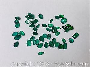 Fifty 13.62 ct Dark Green Emeralds with COA