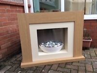 Electric fire with surround.