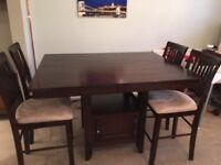 Solid wood counter height dining table & 4 chairs. Great for family gatherings or pub/restaurant