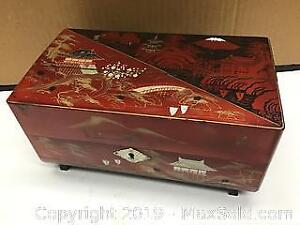 vintage Asian music box featuring bride and groom
