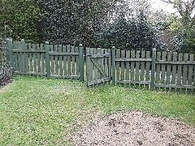 Green timber garden fence 15m long with 2 gates