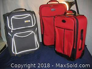 Three Carry On Trolley Bags A
