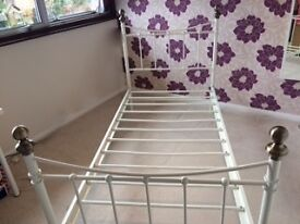 Single white painted bed frame. Excellent condition.